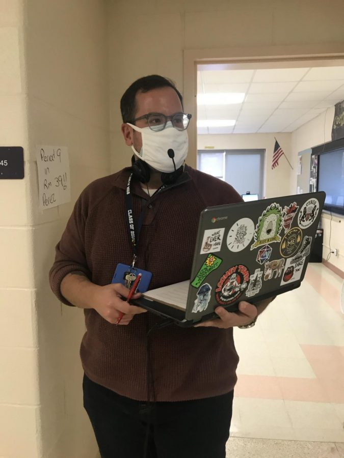 Mr. Perez prepares for teaching his global class virtually and in-person simultaneously.